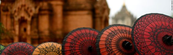 BAGAN, MYANMAR - 2012/11/13: BAGAN. The historical former capital of Burma is a major tourist destination and call in more and more foreign visitors. It's infrastructure to wellcome tourist is largely underdevelopped. Selling local umbrella to tourist.. (Photo by Roland Neveu/LightRocket via Getty Images)