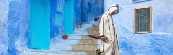 A man walks to work on a rainly Tuesday morning in Chefchaouen, Morocco
